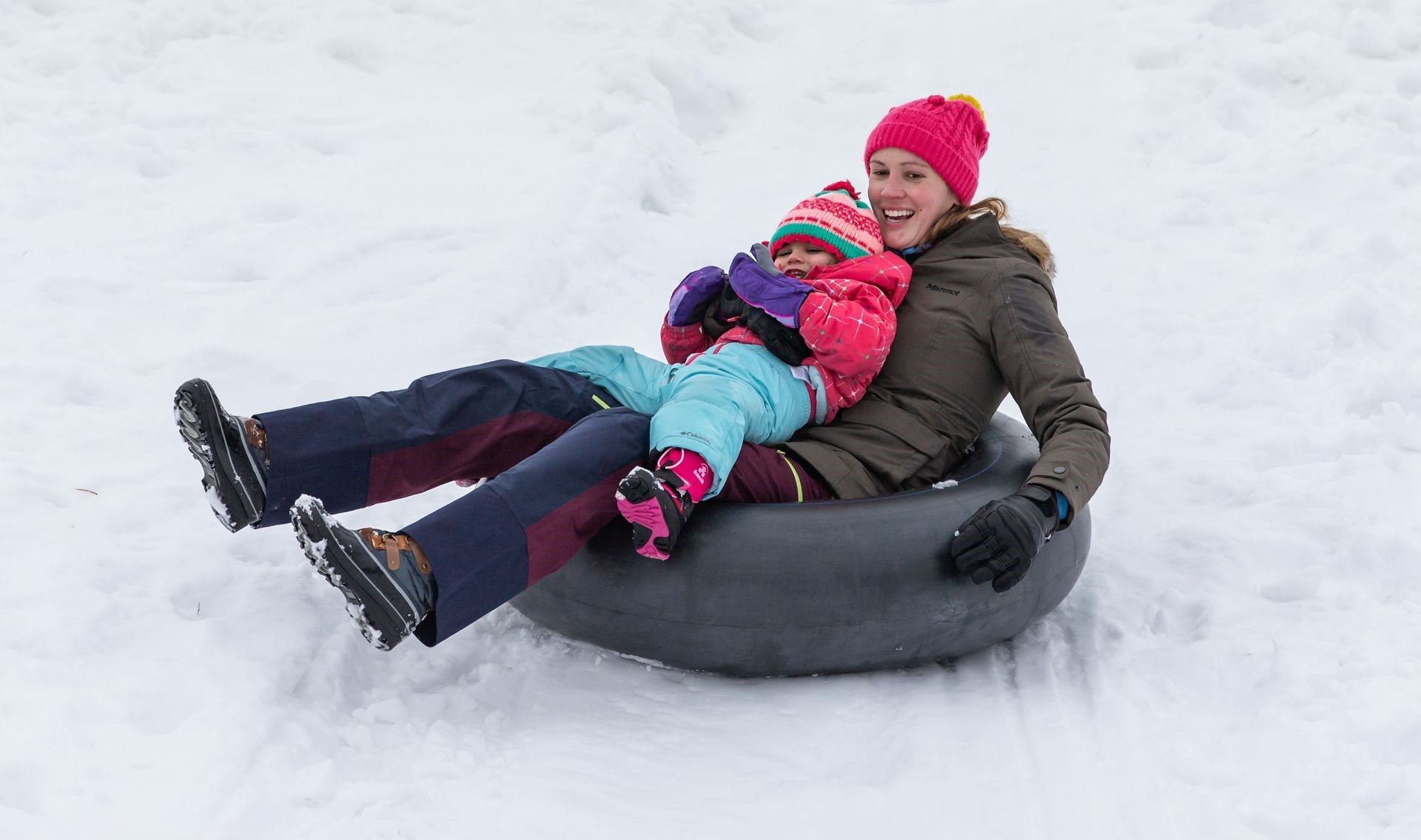 Amanda Steele of Mequon and her daughter Everly, 2, zoom down the Mee-Kwon Park sledding hill in Meq