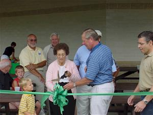Rosemary Tendick Cutting Ribbon at Tendick Park Shelter Dedication