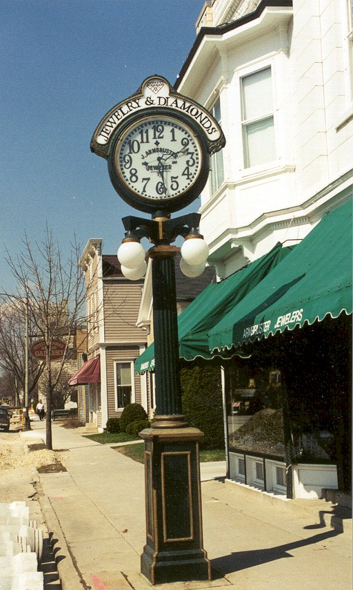Green street clock in downtown Cedarburg.