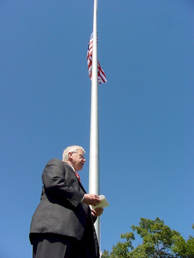County Board Chairman Gus Wirth with American Flag
