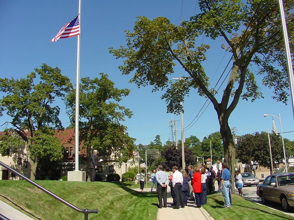 Group of spectators and the American Flag on Patriot's Day 2002.