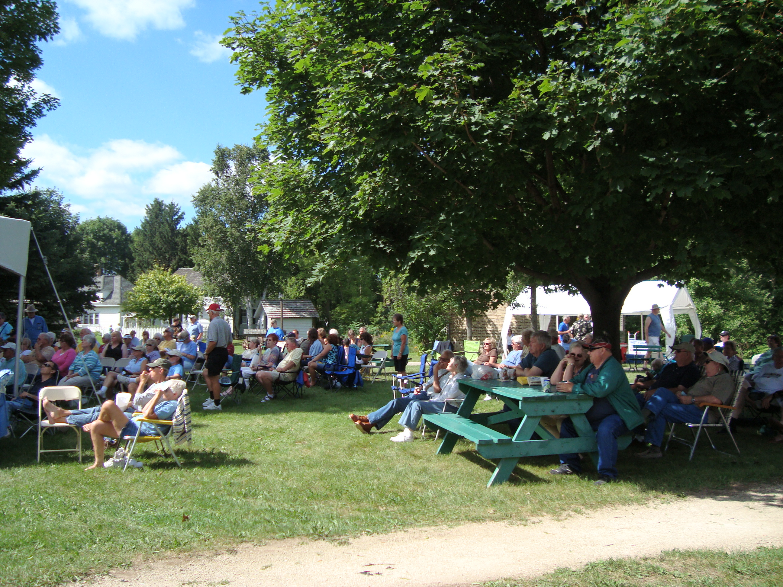 Crowd Enjoys Bluegrass Music in Sunny Weather
