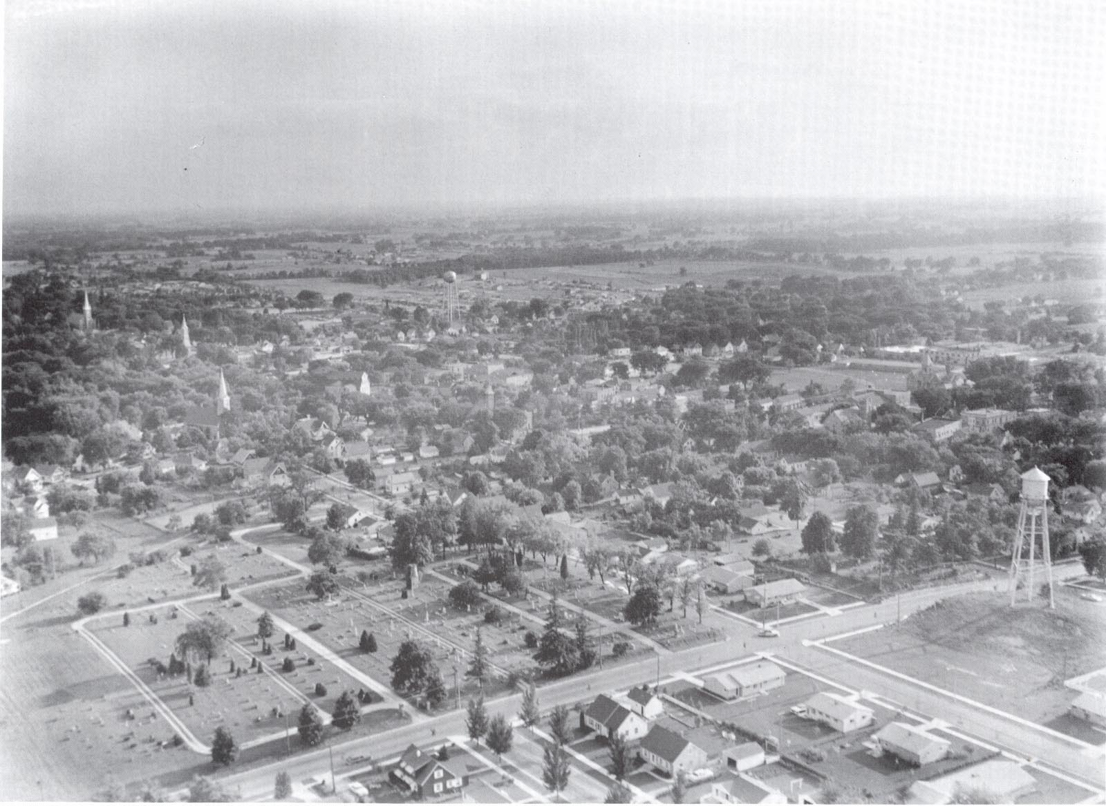 Cedarburg's principal landmarks, the 5-story grist mill, the Lincoln Building, various churches, and the old water tower are all visible in this period aerial photograph.