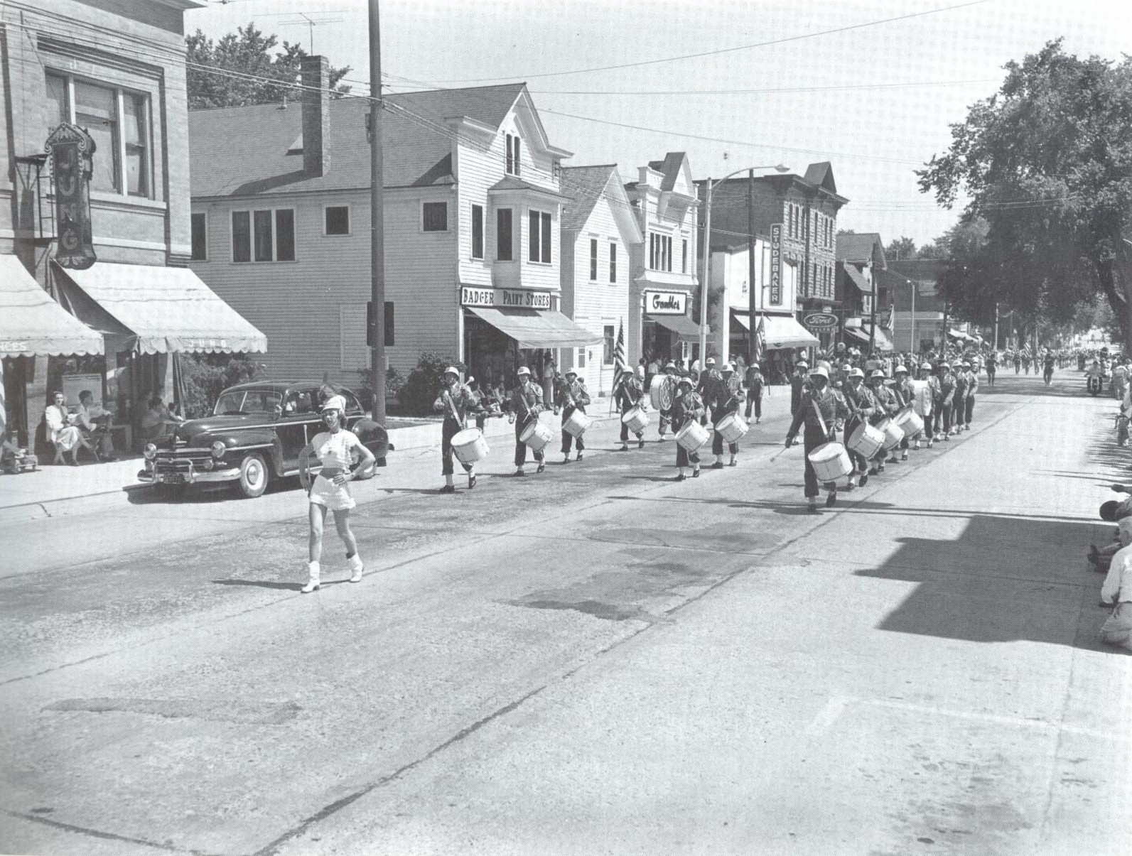 Old photo of a parade marching downtown.