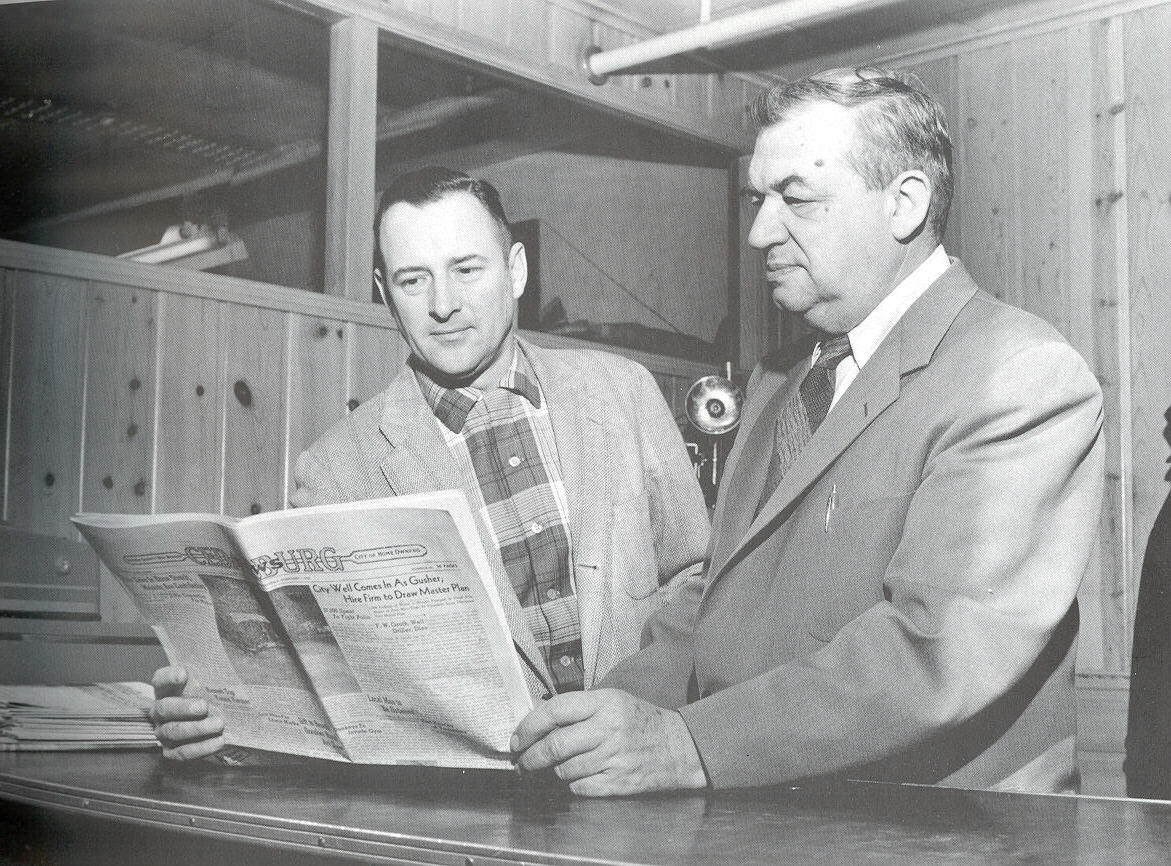 Publisher Adlia Horn and Editor Robert Schroeder, Sr. reading the Cedarburg News.