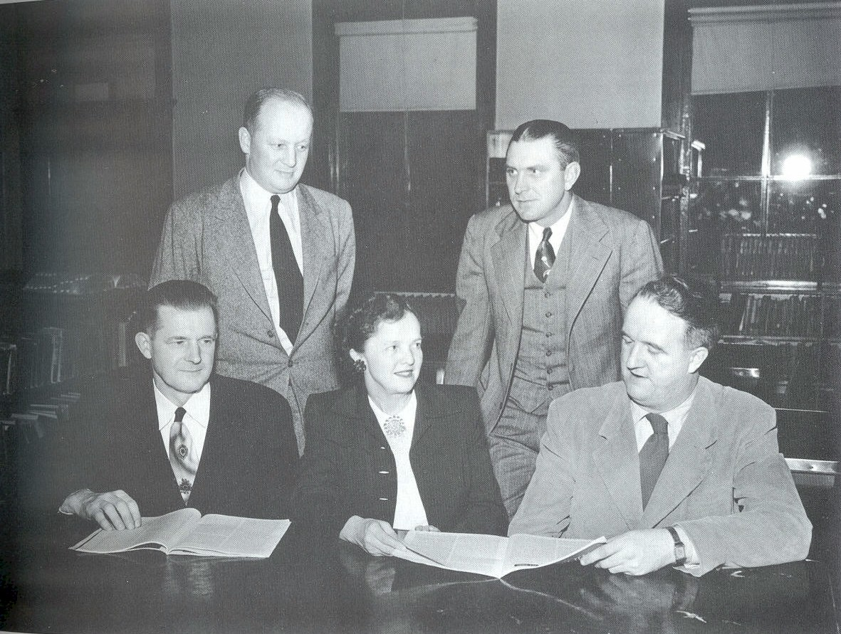 Lou Kopp (center) surrounded by the 4 male members of the school board.