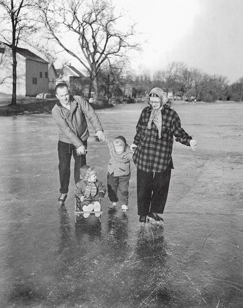 Family enjoying ice skating on the icy streets of Cedarburg.
