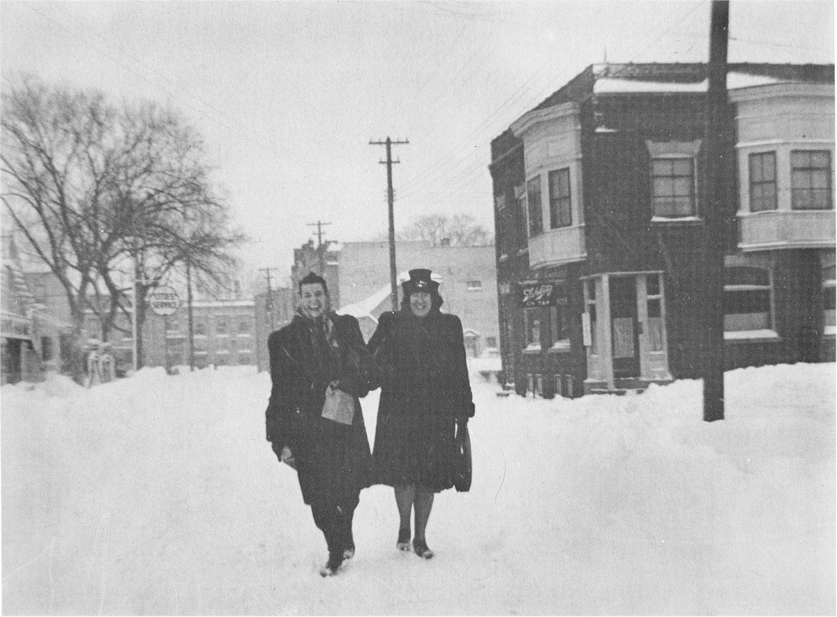 A couple of teachers enjoying walking in the big snow.
